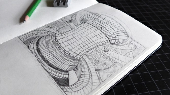 Photo of sketchbook displaying initial pencil sketch of a tokamak for WORK